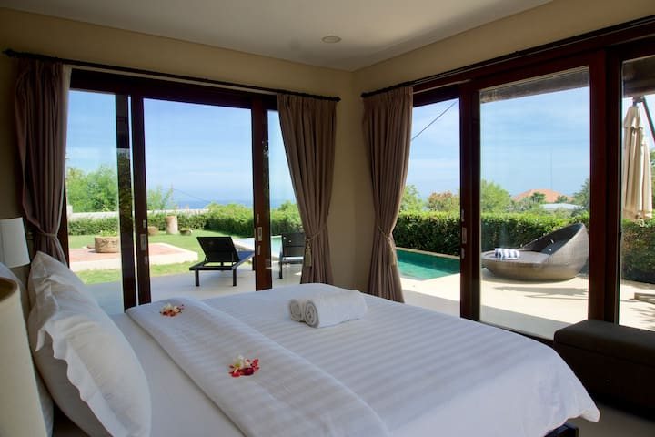 Ground floor master bedroom with ensuite bathroom and walk in wardrobe - pool and sea view