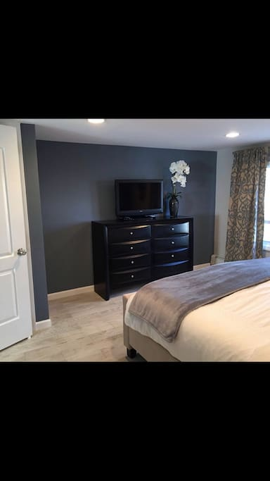 King size bedroom, flat screen, closet, dresser, 3 drawer night stand