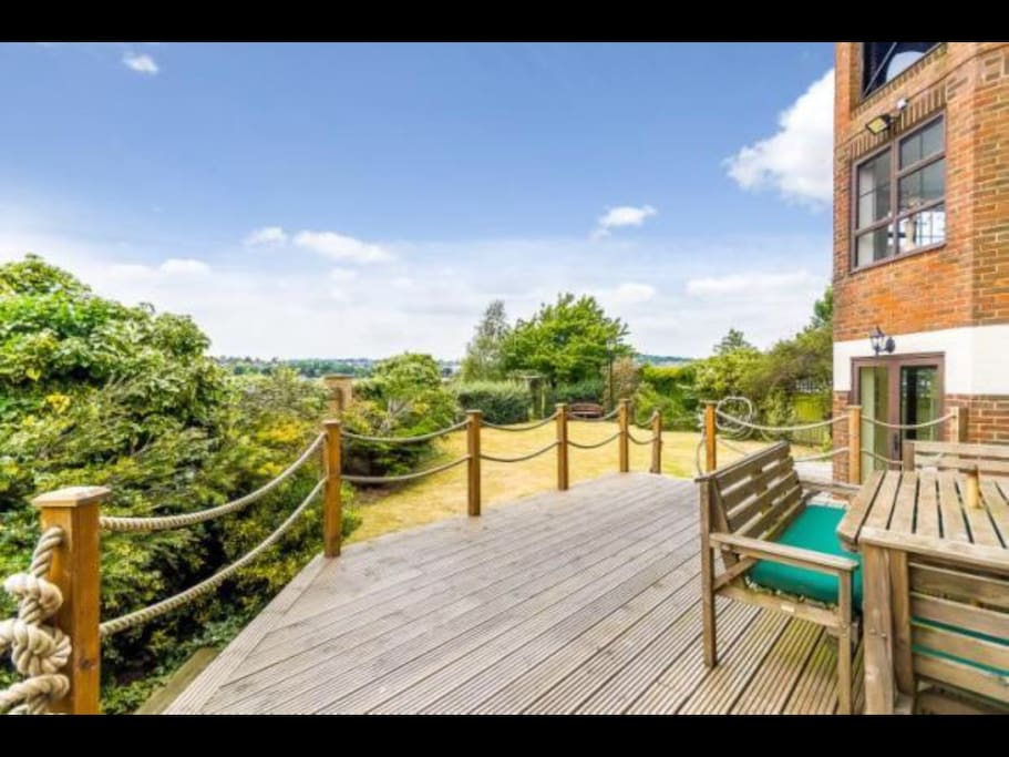 Outside dining area on wooden deck