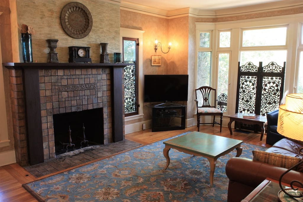 Spacious living room with Batchelder tile fireplace