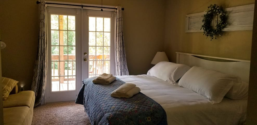 Master suite with King size bed and sun rising view.