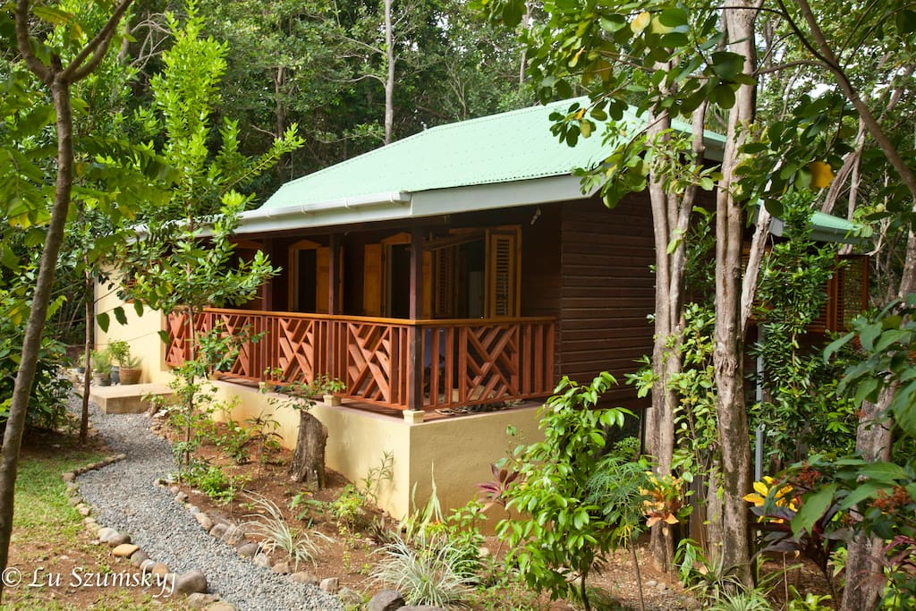 Verandas face the garden in front, the forest and ocean in back