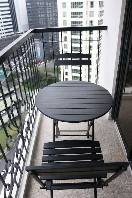 The balcony with a 2-seater dining set.