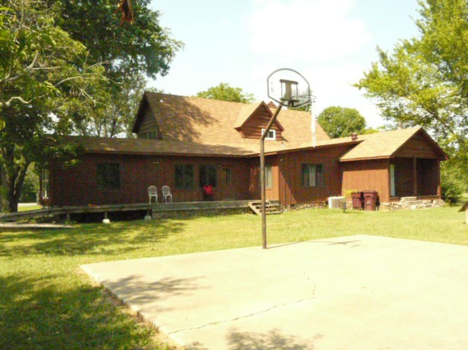 Basketball court.  Deck.  Also has a garden/farm in backyard with chickens, goats, rabbits.