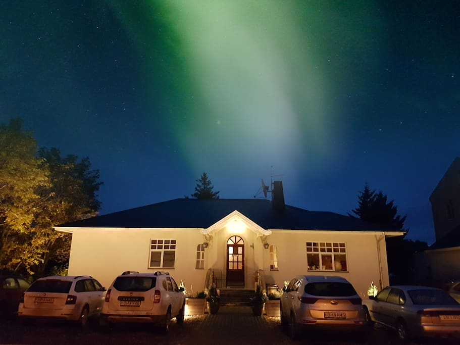 Northern Lights above our house. It is often best to see them standing in our parking lot.