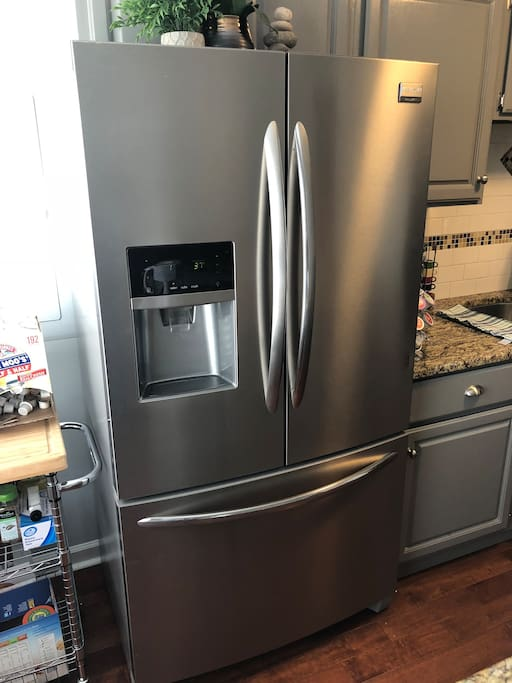NEW FRIDGE:  Recently upgraded refrigerator to one with a water dispenser on the door. (not pictured in original kitchen photos.)    French opening up top and freezer on the bottom. ...More user friendly :)