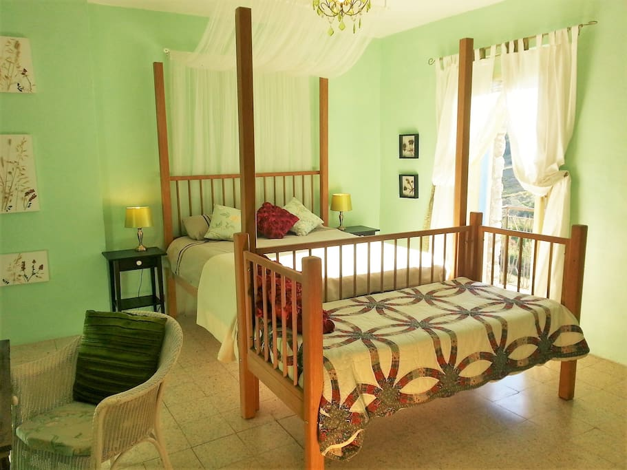 Master bedroom, four poster bed, day bed and ensuite bathroom