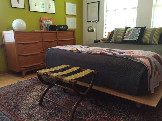 Queen size bed in bedroom, and available dresser space.  Original animation and Pop Art surround you.  A portable record player and selection of vintage LPs may entertain you, or choose from a selection of board games.