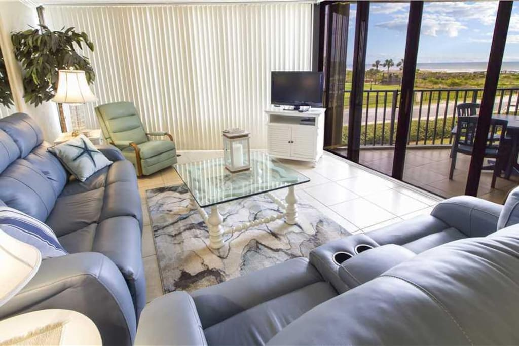 Family Room with a View - Enjoy sitting on the couch and playing a game of cards or watching the breeze float through the palm tr