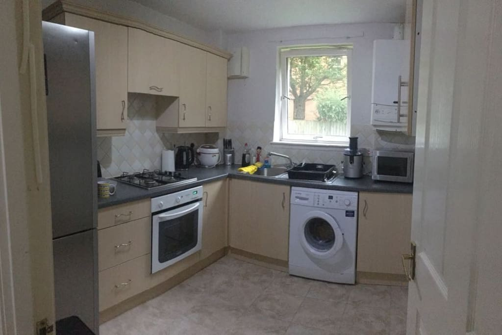 Kitchen with microwave, oven and washer.
