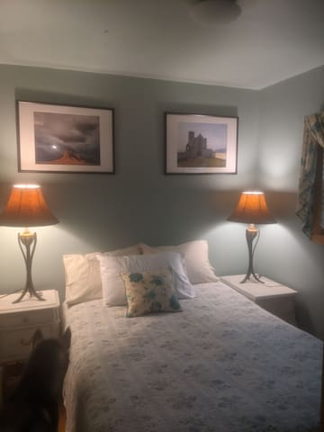 Bedroom number one is cozy and located off the front door, there is a good size closet, lamps on the bedside tables and plenty of extra outlets.