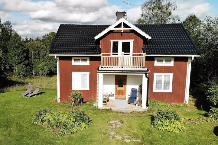 Old-style Swedish country house with big garden