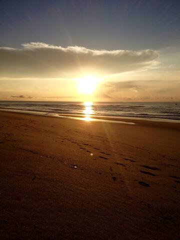 This beautiful beach sunrise is a short 4 min drive from the condo.