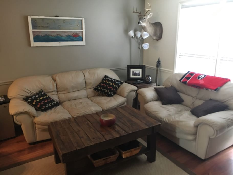 Living room: Leather Couch, Love Seat and Chair.