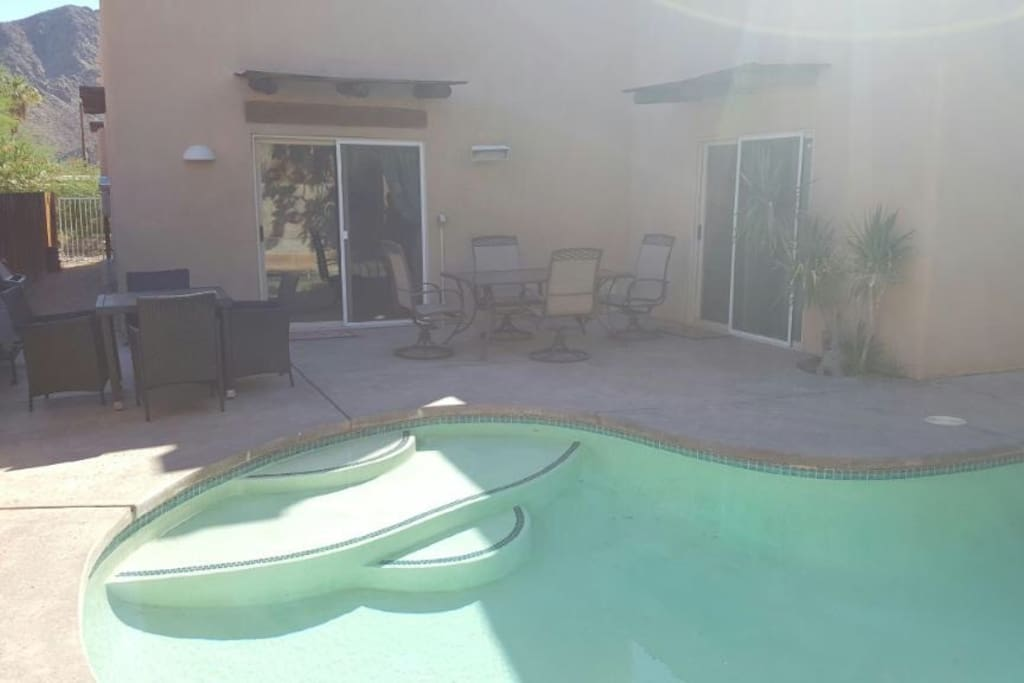 Patio area with BBQ and patio tables.
