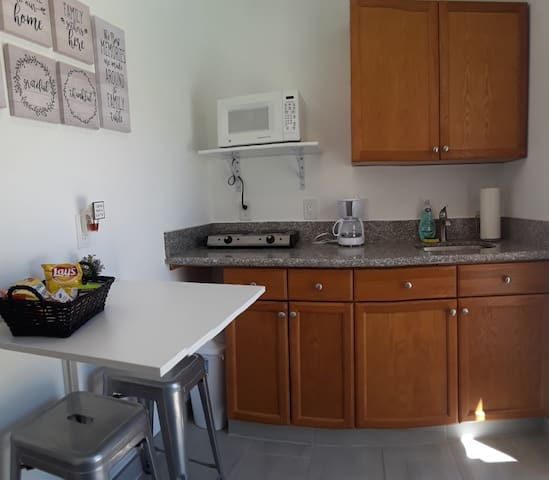 Nice little kitchen with with microwave, coffee maker,toaster, electric 2-Burner kitchen , refrigerator ,dishes and silverware