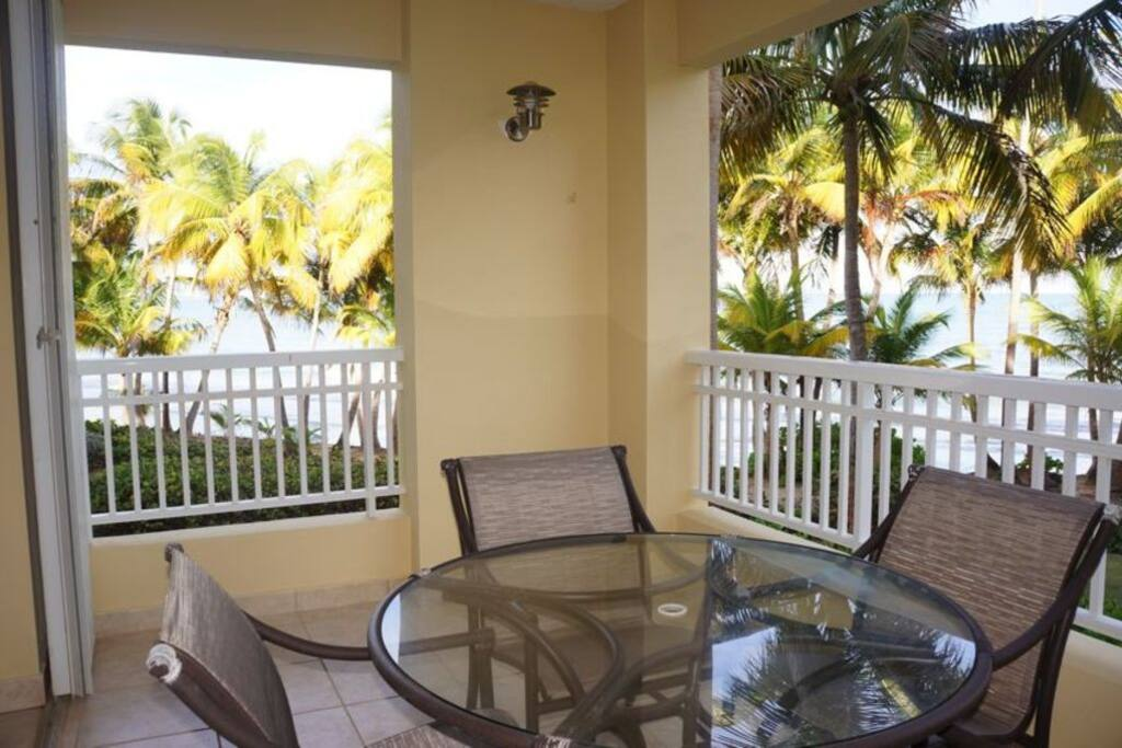 Our porch with wide views of the ocean.  Listen to the waves as you enjoy a refreshment!
