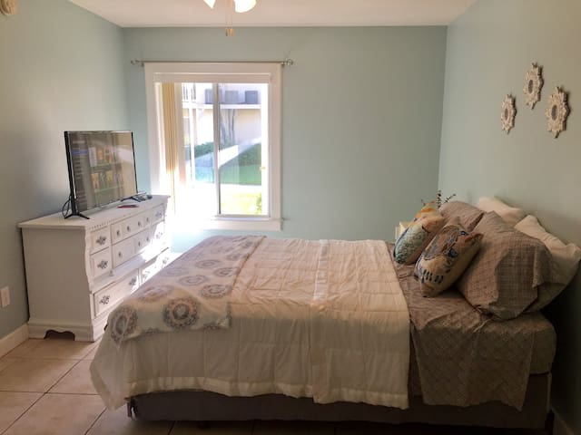 Wake up to Florida sunshine in our  roomy bedroom and Queen size bed.