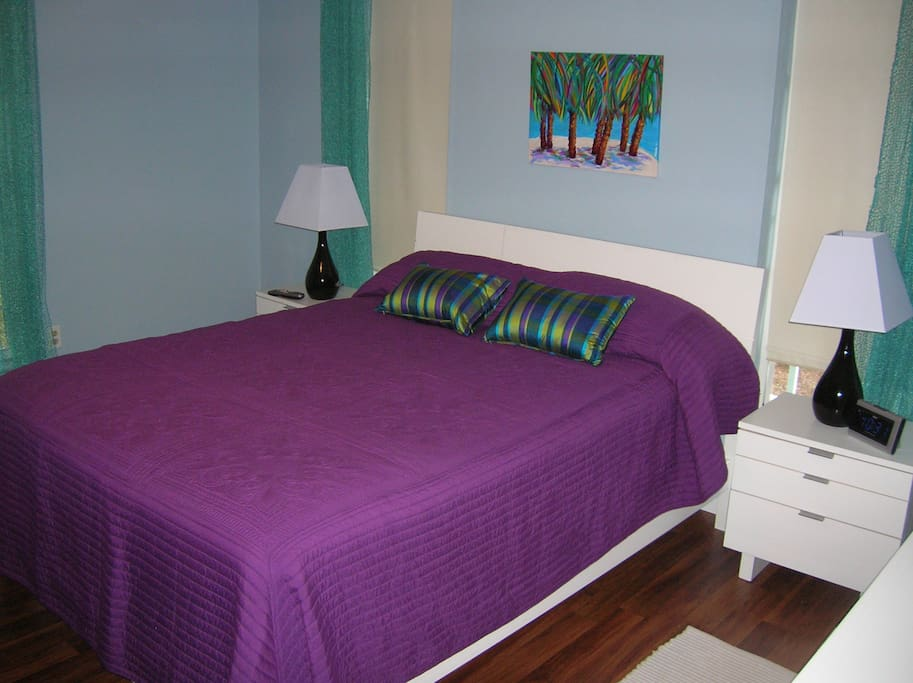 Queen bed with private bathroom.