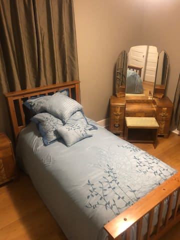 Twin bed soft mattress and twin cot in this comfy space.