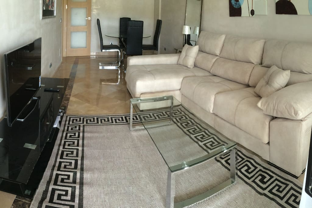 Living room with TV and dining area