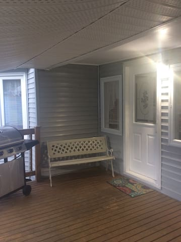 This is the entry into Mission Home. A comfy spot to sit outside with an awning to keep you from the weather.  Also the BBQ is free for the using. Please remember to shut off the propane when finished.