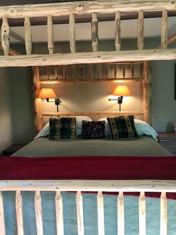Adirondack king sized bed with English linens and the most comfy mattress made