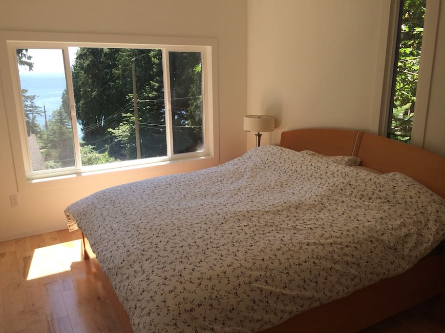Sleep soundly in the master bedroom's king bed and wake up to the ocean view