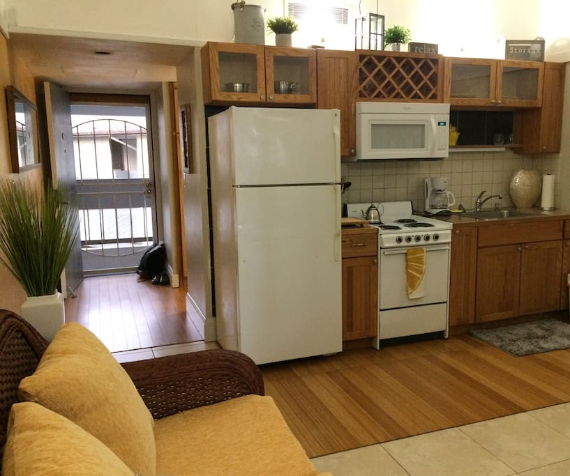 Kitchen area provides dinnerware, cookware, and full size appliances for cost effective at home meal prep.