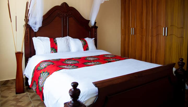 Private en-suite room with a Queen bed in Kitale