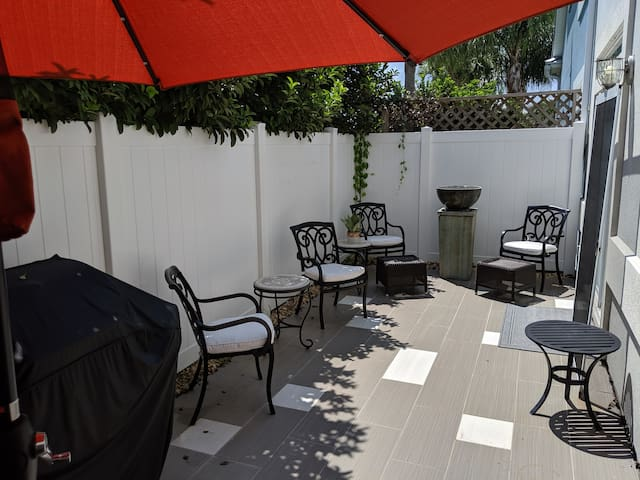Side patio, including zen fountain, NEXT grill with side burner, umbrella, outside shower.