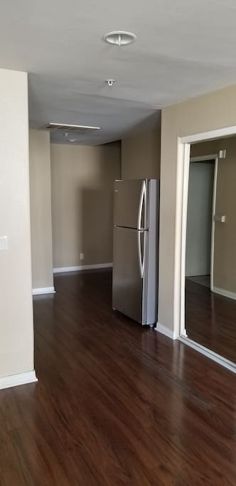 Full size Refrigerator next to large clauset