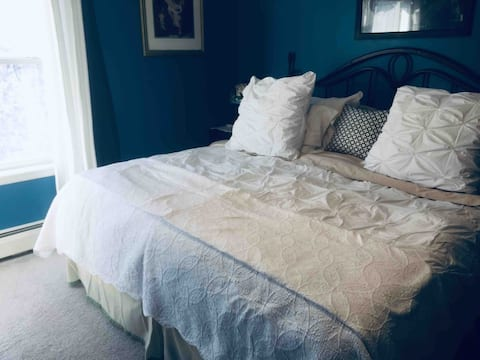 Bright blue bedroom with king bed & desk !