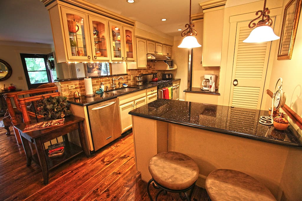 Beautiful upgraded kitchen has everything you could need to cook including 6 burner stove and spice rack!