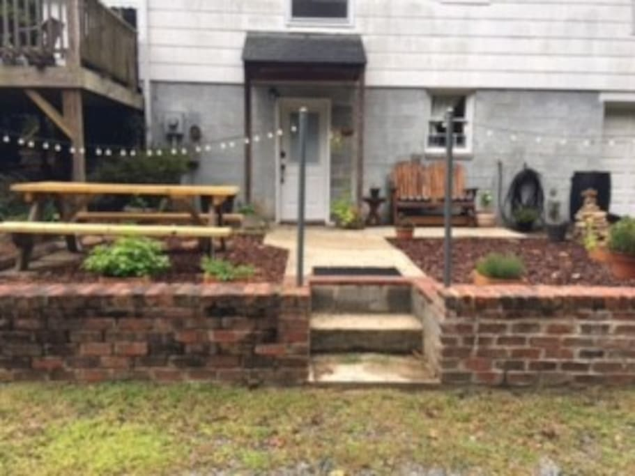 Outdoor space with fresh herbs to cut, picnic table and your own private entrance.
