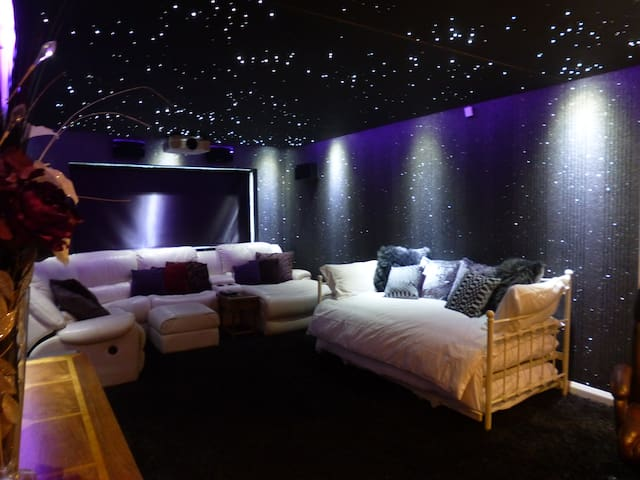 cinema room with double day bed