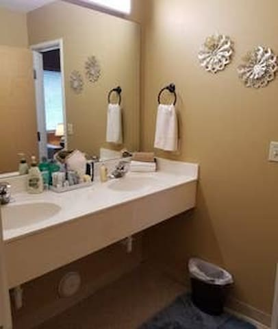 Private bathroom with lots of amenities including a hair dryer.