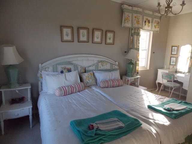 One of the sunny bedrooms with a sea view. The room has two single beds which can be turned into a kingsize bed. There is an ensuite bathroom across a small bathroom. Tea making facilities are in the bedroom
