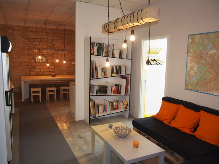 Common area with dining space and chill area with books and games