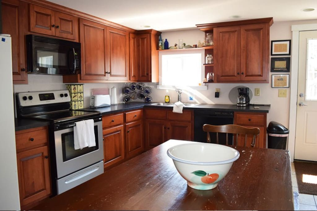 Fully equipped kitchen with two separate refrigerators.