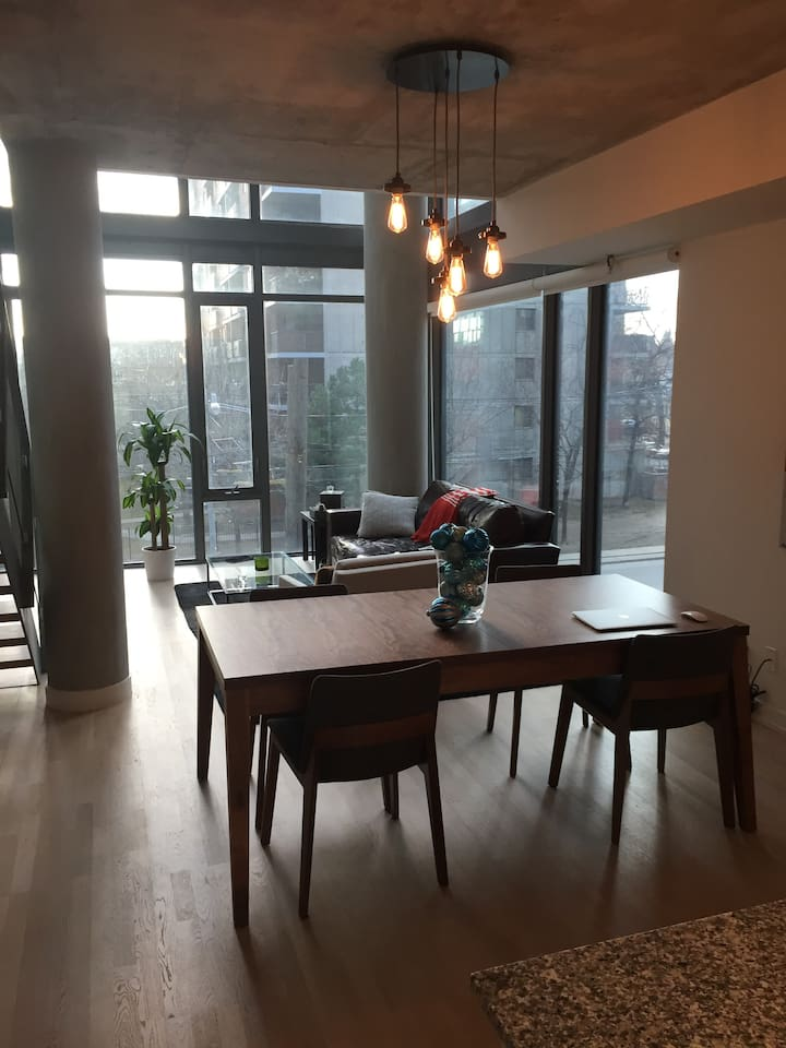 Open living/dining room with 20ft of windows