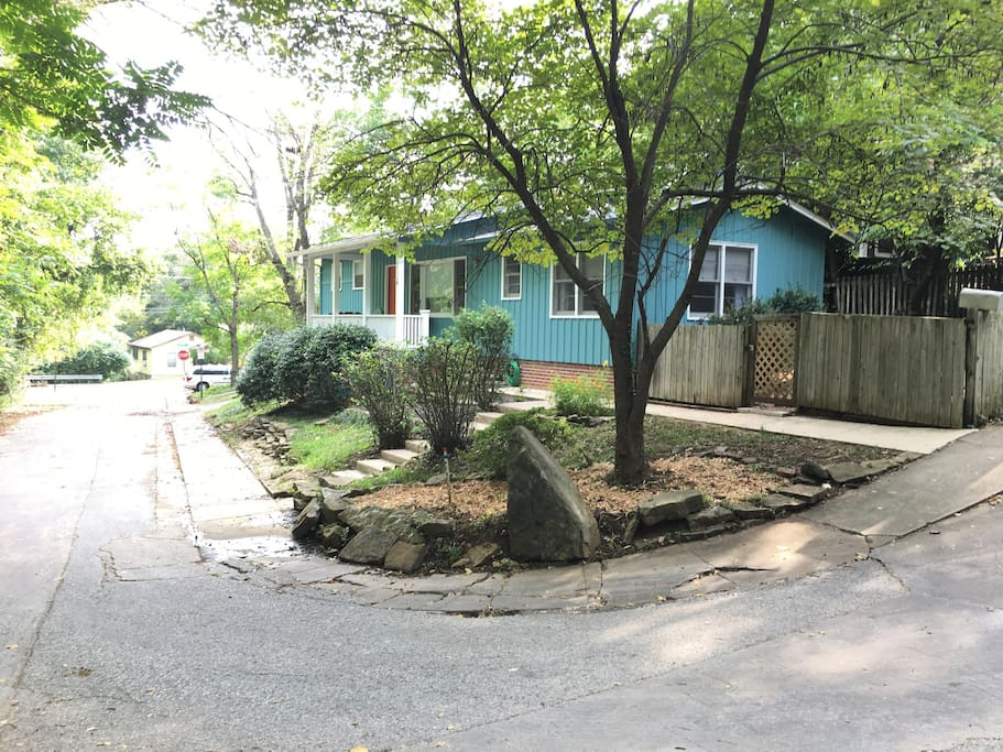 Nestled on a short, hidden one-way street in the historic district - the Blue House overlooks Spout Spring Branch creek.