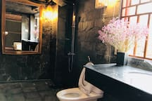 very large bathroom and toilet with window