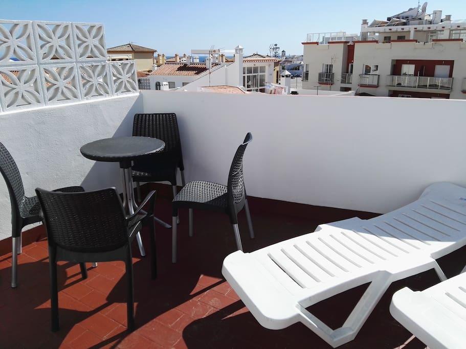 In the terrace. En la terraza.