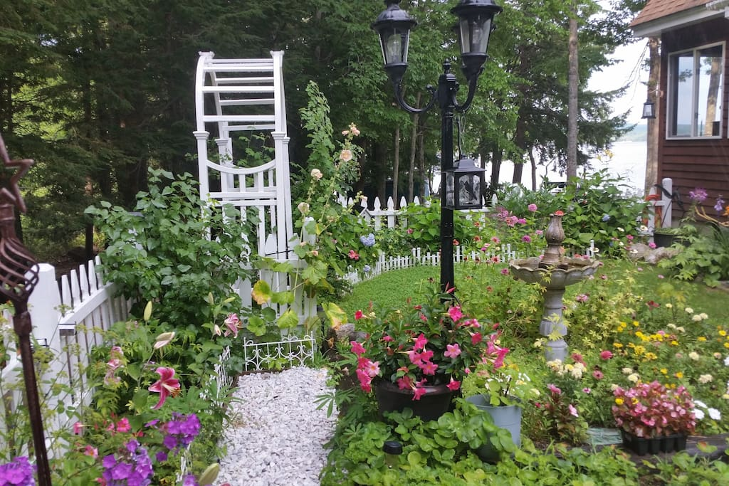 On the way to the cabin -- don't forget to enjoy the garden.  The cabin is located down the drive beyond the picket fence.