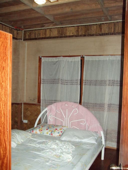 One of two identical bedrooms