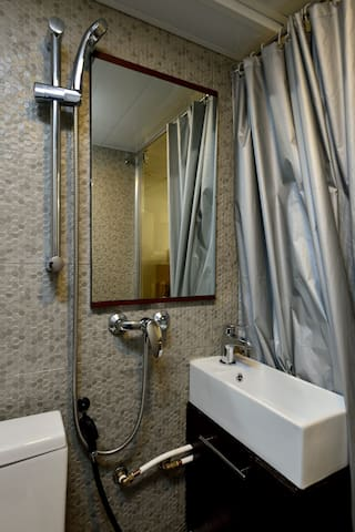 The Bunk Dorm Room has a shared full bathroom with shower