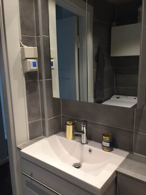 Brand new bathroom with washing machine and heating.