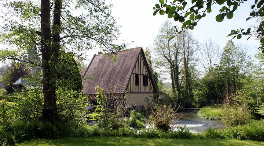 Authentic old mill river in Normandy countryside