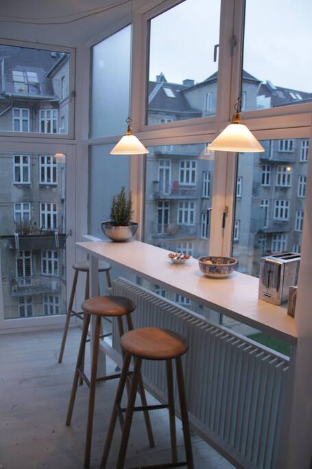 The kitchen with  panoramic windows and french balcony.